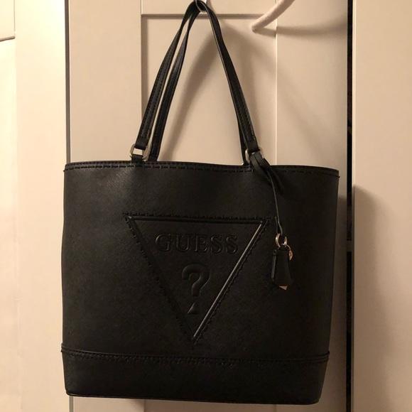 16e1690fbb Guess Handbags - Guess Black Classic Tote Handbag With Tassel Chain